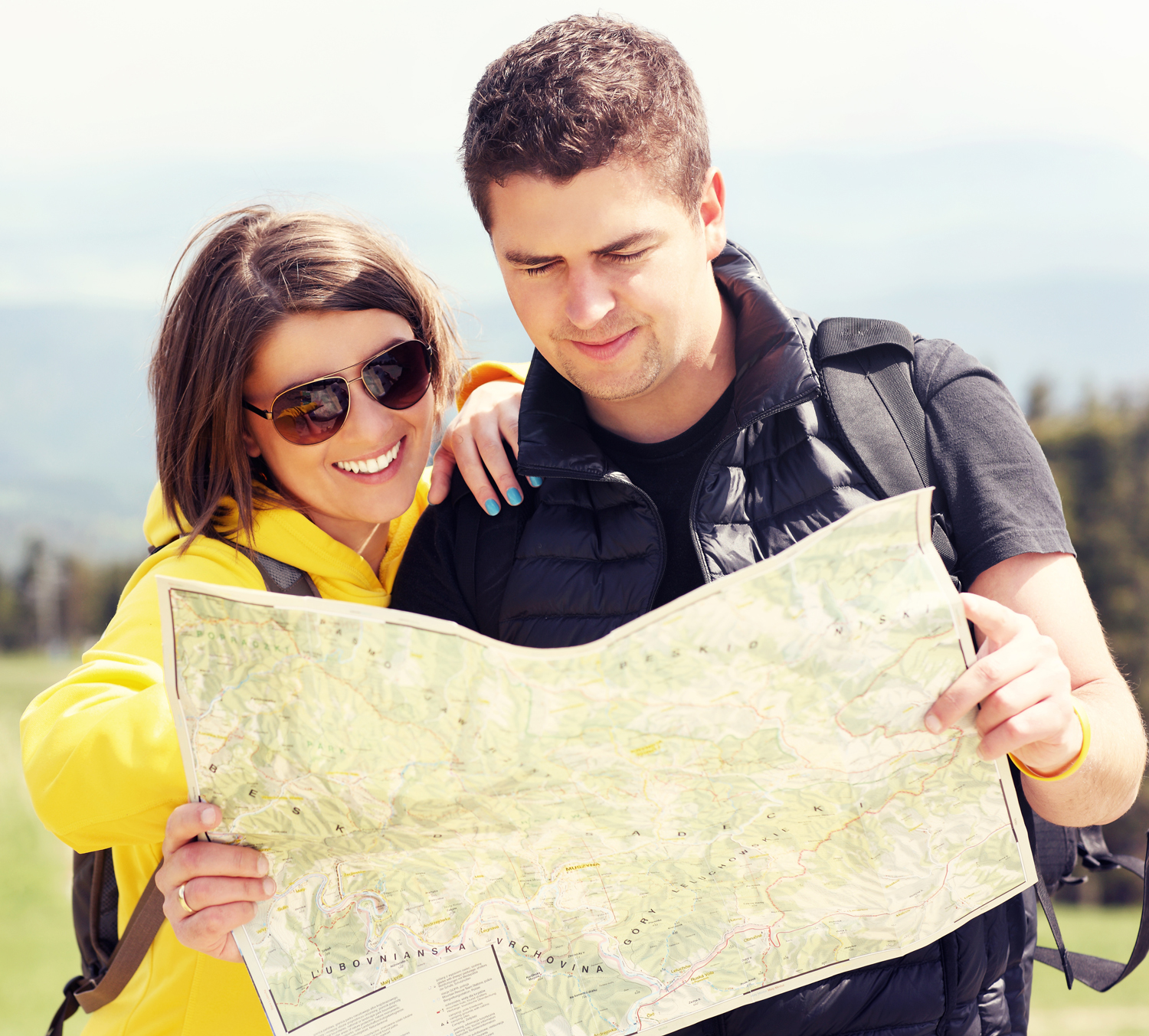 Young couple with map in mountains