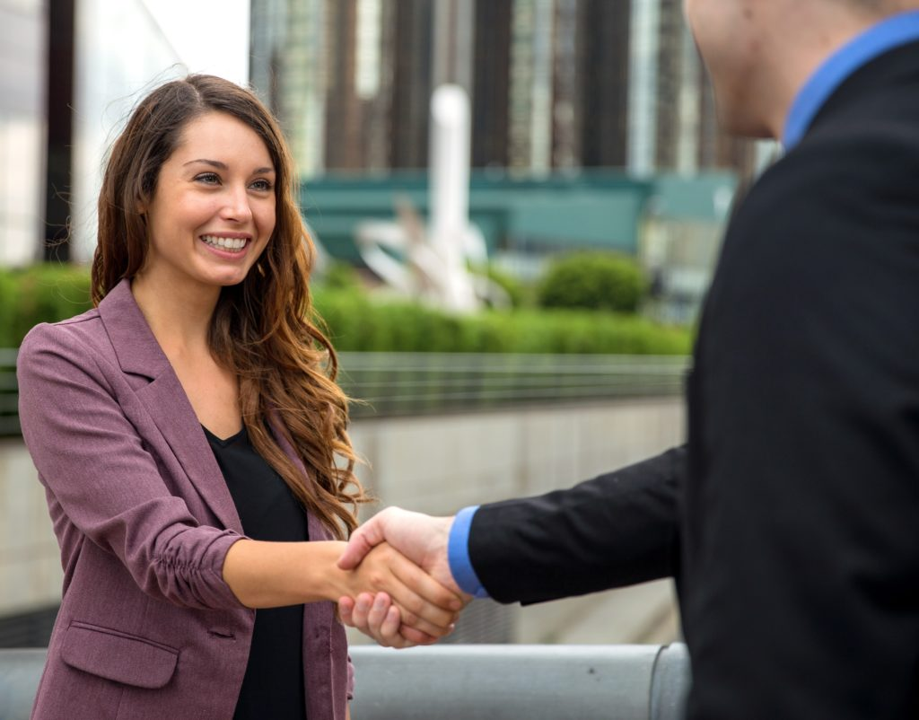 Partners finance success sales person shaking hands greeting meeting first time